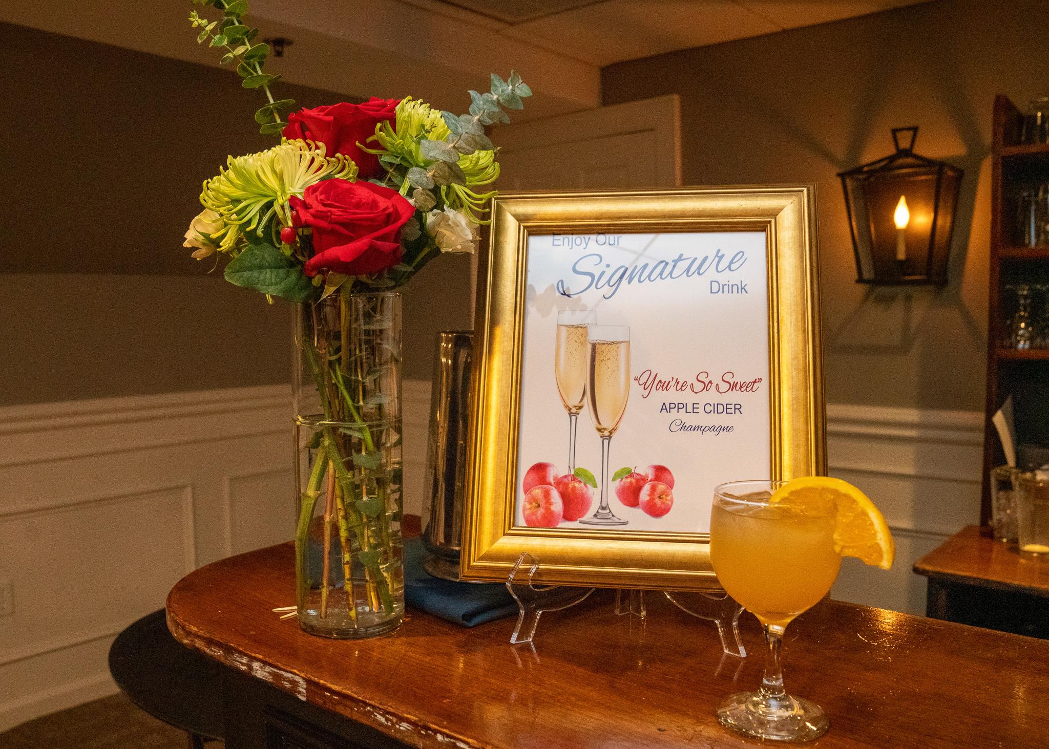 Bar flowers and custom bar sign