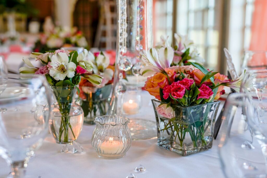 Small vases filled with bright flowers